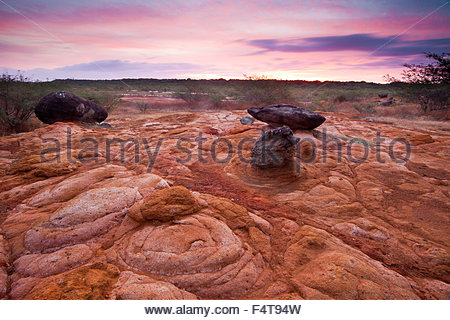 Volcanic rock formations and colorful skies at sunrise in Sarigua national park (desert), Herrera province, Republic - Stock Photo