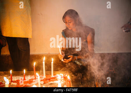 Dhaka, Bangladesh. 22nd Oct, 2015. Devotees lightened the candles inside the temple during the Durga Puja celebration. - Stock Photo