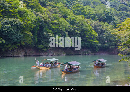 Japan, Kyoto City, Arashiyama Mountain, Oi River, boat - Stock Photo