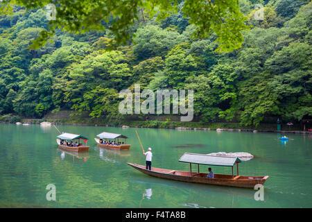 Japan, Kyoto City, Arashiyama Mountain, Oi River, boat - Stock Photo