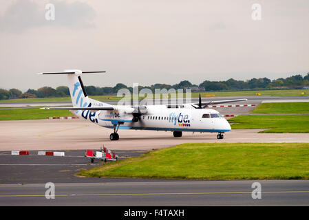 Flybe Airlines Bombardier Dash8-402Q Turboprop Airliner G-JECN Taxiing at Manchester Airport England United Kingdom - Stock Photo