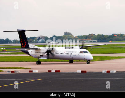 Brussels Airlines Bombardier Dash8-402Q Turboprop Airliner G-ECOI Taxiing at Manchester Airport England United Kingdom - Stock Photo