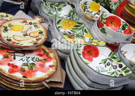 Traditional pottery on sale in the market in the eastern lakeside town of Malcesine, Lake Garda, Italy on 17th October - Stock Photo