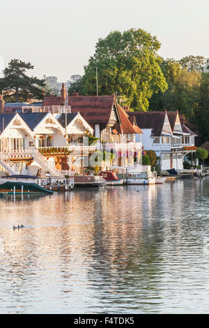 England, Oxfordshire, Henley-on-Thames, Boathouses and  River Thames - Stock Photo