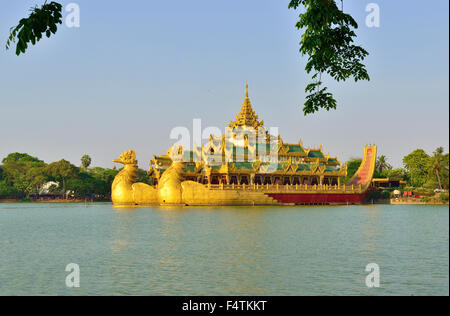 Karaweik restaurant, the golden  dragon boat, on  Kandawgyi Lake, is a reproduction of a royal barge Rangoon, Yangon, - Stock Photo