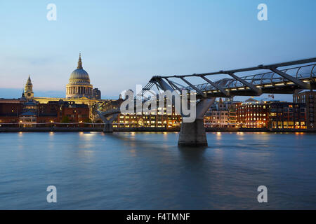 St Paul's Cathedral and Millennium bridge in London at night, natural colors - Stock Photo