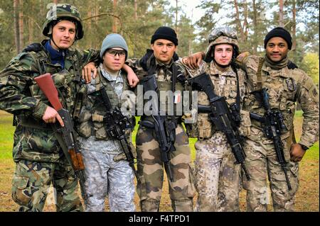 Multinational soldiers competing in the European Best Squad Competition pose for a photo at the Grafenwoehr training - Stock Photo