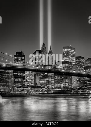 The Tribute in Light, in Lower Manhattan with illuminated skyscrapers of the Financial District, New York City, - Stock Photo