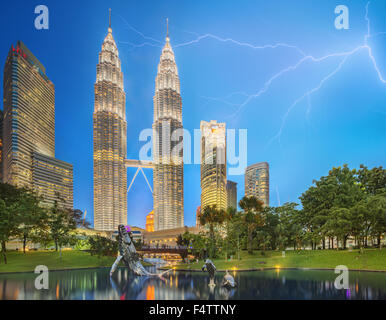 Dramatic scene of thunderstorm and modern asian architecture, skyscrapers and tallest building of Malaysia - Stock Photo