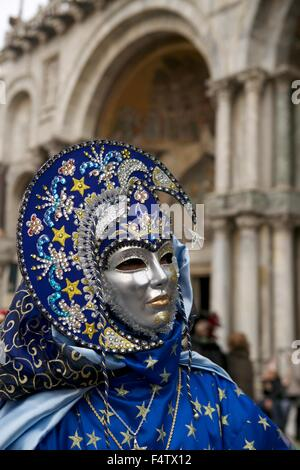 Carnival of Venice Venezia mask disguised moon stars blue outfit beautiful mask ornament Piazza di San Marco San - Stock Photo