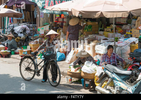vietnamese ladies managing their food stalls at the market in hanoi old quarter,Vietnam - Stock Photo