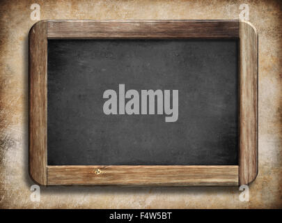 old vintage blackboard with wooden frame on grunge background - Stock Photo