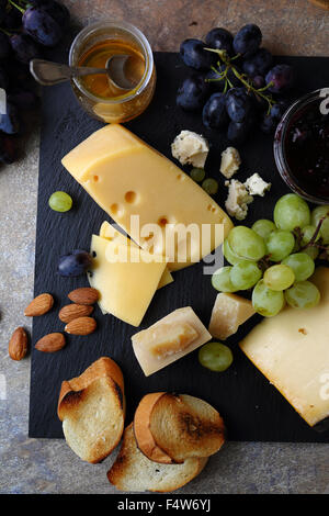 cheese and fruits on slate, food above - Stock Photo