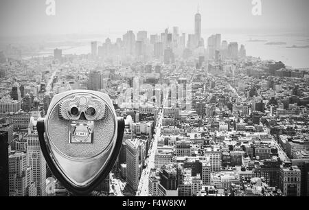 Black and white toned tourist binoculars over Manhattan Skyline, New York City, USA. - Stock Photo