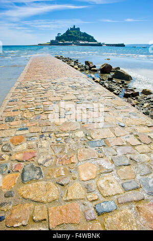 A view of St Michael's Mount with the granite causeway in the foreground. - Stock Photo
