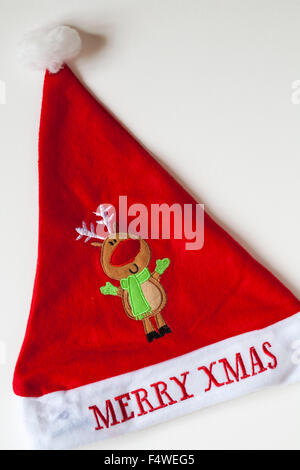 Merry Xmas Christmas hat with Rudolph red nosed reindeer on set on white background - Stock Photo