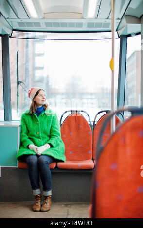 Young woman in tram - Stock Photo