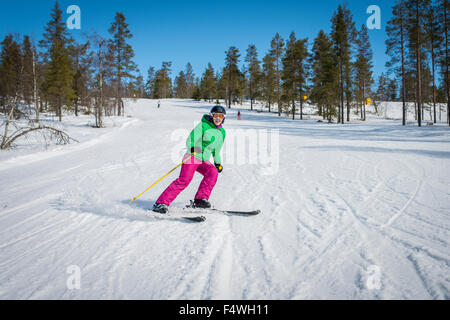 Finland, Lapland, Levi, Portrait of mid-adult woman skiing - Stock Photo