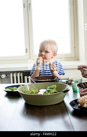 Finland, Helsinki, Kallio, Boy eating lunch - Stock Photo