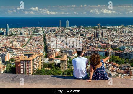 Tourists watching the city skyline, Barcelona, Catalonia, Spain - Stock Photo