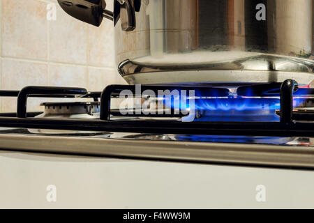 Cooking Plate: Cooktop - Gas Stovetop Burning in Light Background - Stock Photo