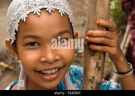Portrait of a girl near Phong Dien. Mekong Delta. Vietnam South Mekong Delta Chau Doc Cham Moslem village face of - Stock Photo