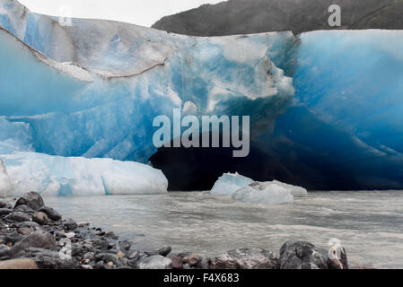 Entry way to a blue ice cave on an Alaskan cruise excursion hike to Davidson glacier near Skagway Alaska   Inside - Stock Photo