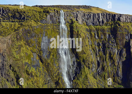 Rocky cliffs and waterfall just east of Seljalandsfoss, Iceland - Stock Photo