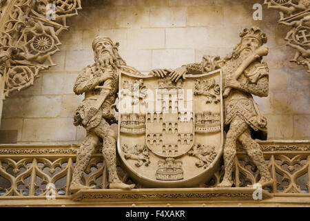 BURGOS, SPAIN - AUGUST 13, 2014: Statues holding a shield at the Cathedral of Burgos, Castille, Spain - Stock Photo