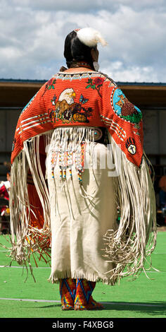 Elegantly costumed dancer awaits the competiton's start at the American Indian PowWow, the Blackfeet Reservation, - Stock Photo