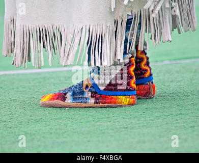 Hand-beaded moccasins highlight a dancer's costume at the Indian PowWow on the Blackfeet Reservation, Browning, - Stock Photo