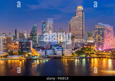 Bangkok, Thailand skyline on the Chao Phraya River. - Stock Photo