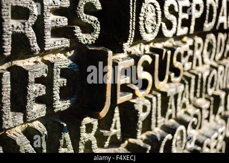 Bronze main door of La Sagrada Familia, the cathedral designed by Gaudi. Architectural detail depicting words in - Stock Photo