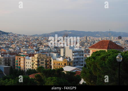 Panoramic view of Barcelona city and Sagrada Familia on a summer day in Barcelona, Spain. - Stock Photo