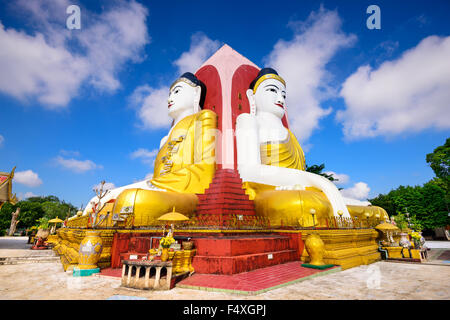Bago, Myanmar Four Faces of Buddha at Kyaikpun Buddha. - Stock Photo
