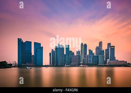 Singapore skyline at Marina Bay. - Stock Photo