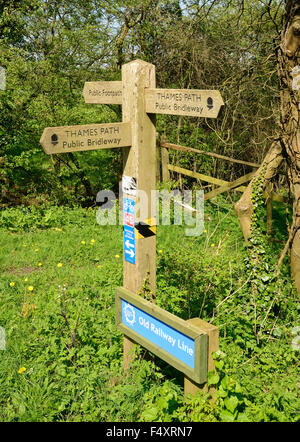Sign beside the trackbed of an old railway line, now a public bridleway and part of the Thames Path and National - Stock Photo