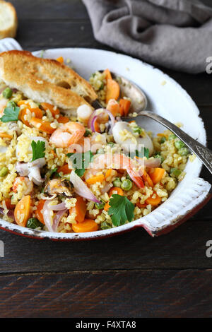 paella with bulgur, food closeup - Stock Photo