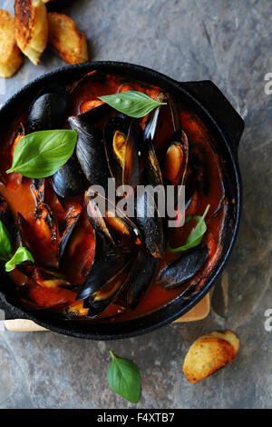 steamed mussels in sauce, food - Stock Photo