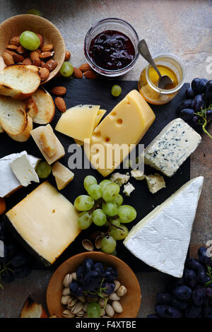 delicatessen cheeses with fruits, top view - Stock Photo