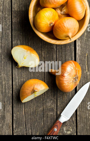 halved fresh onion on wooden old table - Stock Photo
