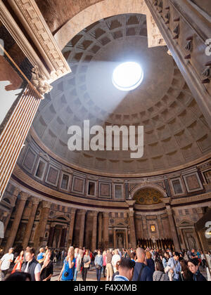 Sublight is shining into the ancient Roman Pantheon temple through the characteristic hole in the middle of its - Stock Photo