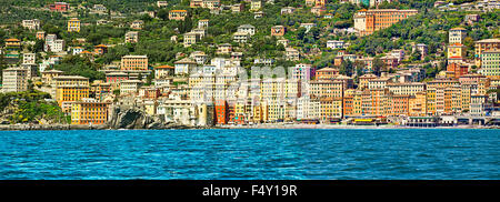 Camogli is a fisher village with a picturesque architecture on the Ligurian coast near Genoa, great tourist attraction - Stock Photo