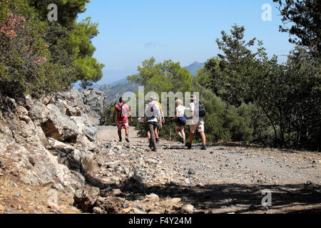 Tourist group and guide on walking holiday hiking in the Turkish Republic of North Cyprus  KATHY DEWITT - Stock Photo