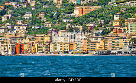 Camogli is a fisher village with a characteristic architecure on the Ligurian coast, very crowded by tourists on - Stock Photo