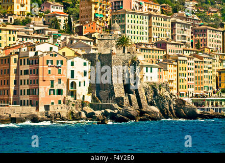 Approaching Camogli from the sea, picturesque fisher village near Genoa Italy witih a characteristic architecture - Stock Photo