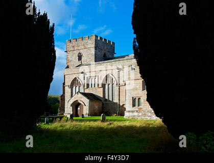 St Andrew's Church, Greystoke, Cumbria, England UK, framed by yew trees - Stock Photo