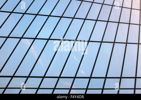 An office tower windows reflecting an early morning image of clouds and sky in Manama Bahrain. - Stock Photo