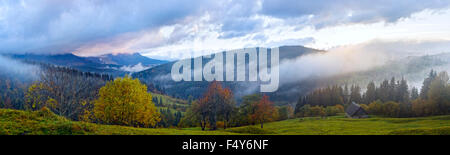 Misty early daybreak in autumn Carpathian mountain, Ukraine. - Stock Photo