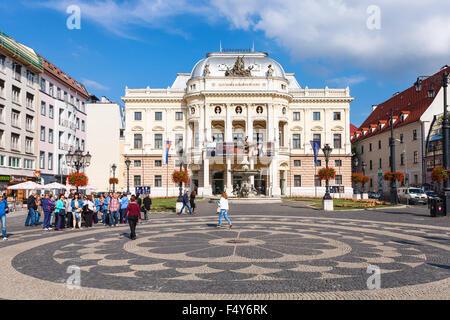 BRATISLAVA, SLOVAKIA - SEPTEMBER 23, 2015: tourists near Old Slovak National Theatre building in Bratislava. It - Stock Photo